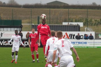 Tendai Chitiza heading the ball.