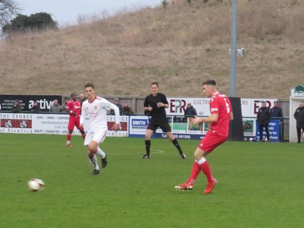 Jordon Cooke passing forwards.