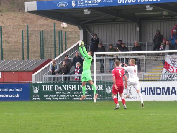 Danny Haystead jumping to catch the ball.