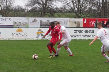 Tendai Chitiza under pressure from Mark Gray.