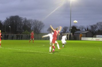 Sam Tingle winning a header.