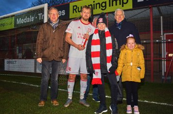 Johnathan Williams being presented with the man of the match award.