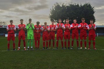 Market Drayton Town holding a minute's applause.