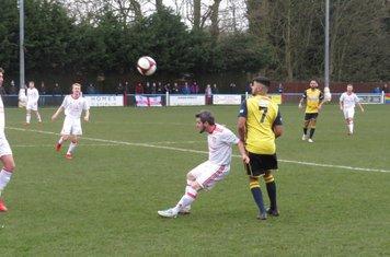 Kallum Smith heading the ball.