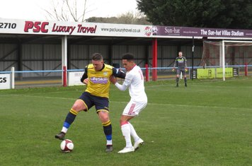 Liam Hughes under pressure from Reon Potts.