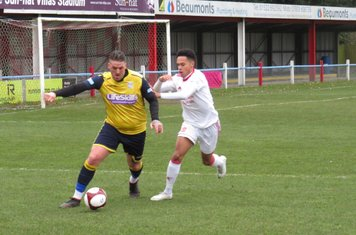 Liam Hughes and Reon Potts in action.