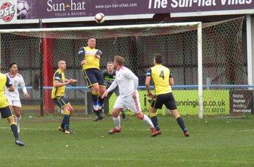 Liam Hughes heading the ball.