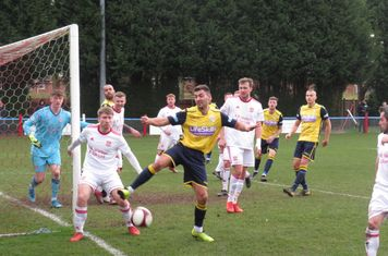 Jonathan Margetts trying to keep the ball in play.