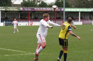 Mark Gray heading the ball.