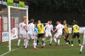 A goalmouth scramble.