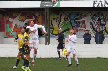 Mark Gray rising high to head the ball.