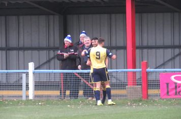 Nyle Blake being congratulated for his second goal.