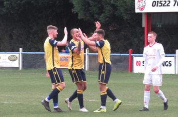 Jonathan Margetts being congratulated for his second goal.