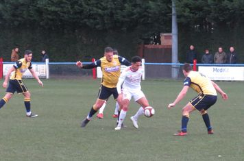 Reon Potts under pressure from Liam Hughes.