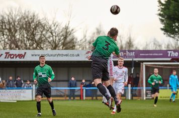 Louis Keenan winning a header.