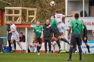 Marc Grocott and George Asplin contesting a header.