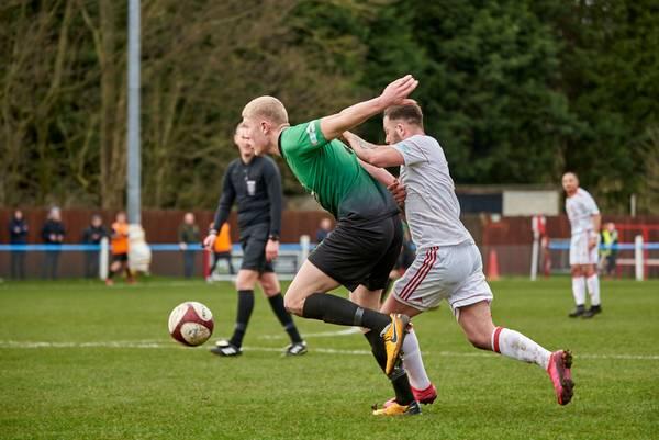 Oliver Harrison under pressure from George Asplin.