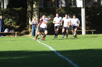 Julian Zürcher running in with the ball in hand.