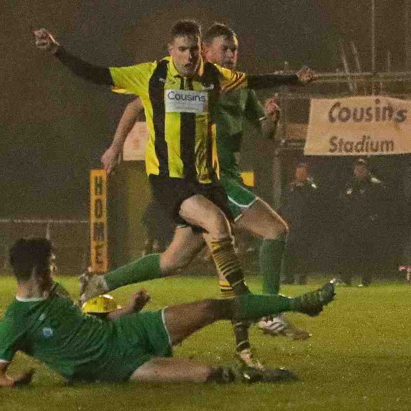 Tomo Anderson skips the Canvey Island defender's slide tackle in style to continue the Bees attack