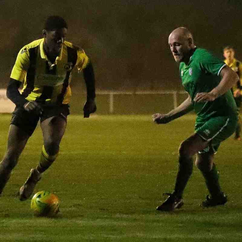 Ayo Odekoya vies with the Canvey Island defender late on in the second-half