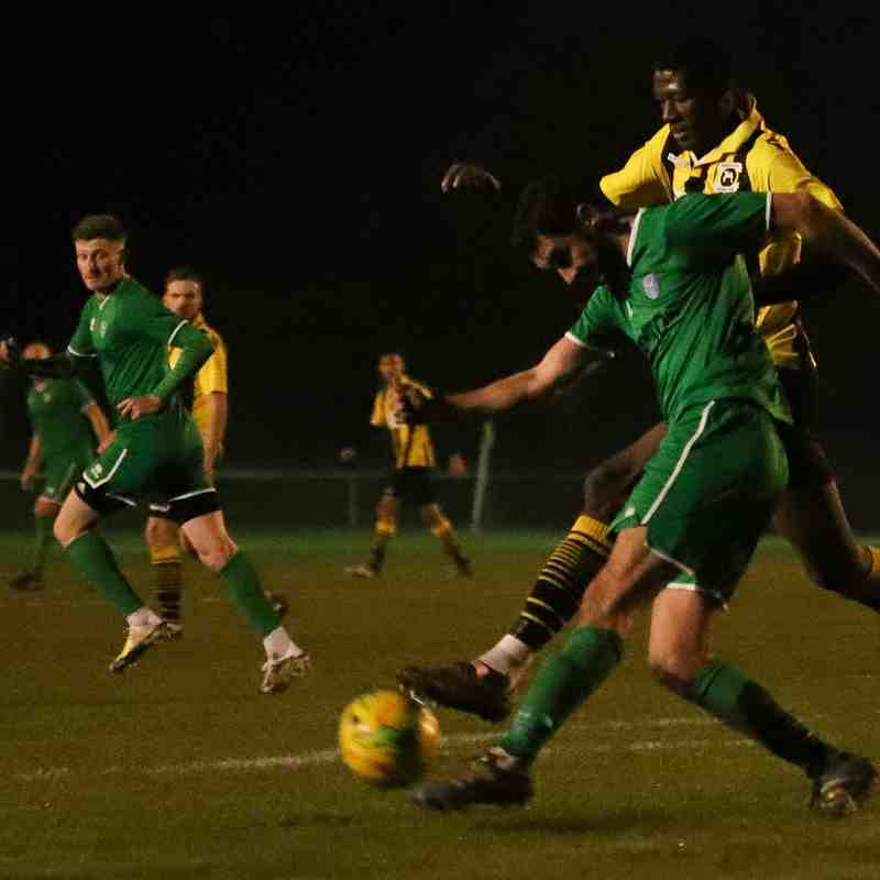 Ayo Odekoya vies for possession with the Canvey Island centre-back