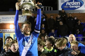 Captain Jimmy Fry Lifts the Trophy!