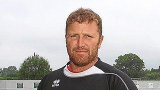 Davies returns as manager