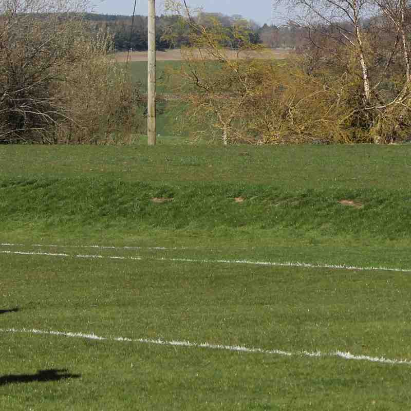 James Hughes tucks his penalty low inside Matthew Dacey's right hand post.