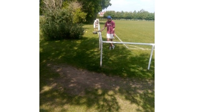 Painting Barriers at the Football Club