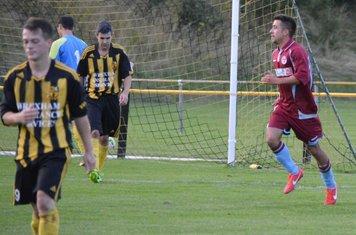 Glen Williams turns away having scored the third goal for Llan