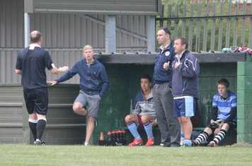 The referee gives the Llan bench a few stern words!