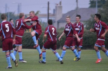 Lunt is congratulated after scoring Llans third and killer goal !