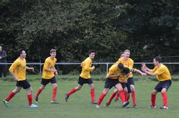 Buckley players celebrate their second goal.