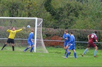Ben Wilson glances a header towards the goal.......