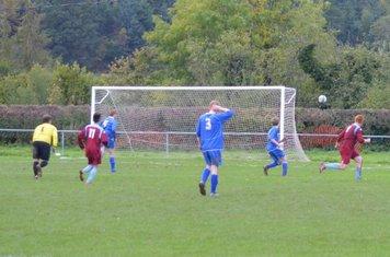 Kristian Jones strikes the ball at an empty net....