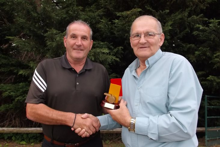 Referee of the year Ian Reid receives his award