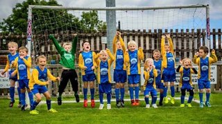 Under 7's dedicate strip to local charity
