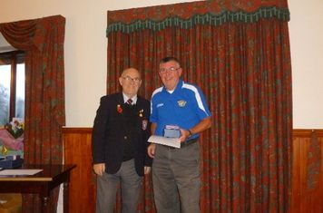 Billy Buck receiving his awards from George Perry LCFA