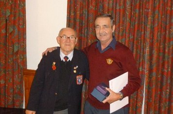 Les Jacques receiving his awards from George Perry LCFA