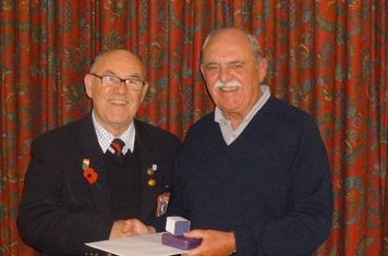 Ronnie Young receiving his awards from George Perry LCFA