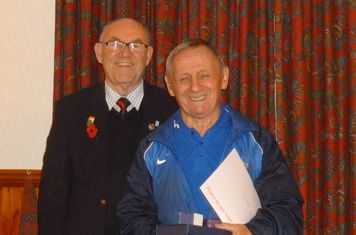 Fred Smith receiving his awards from George Perry LCFA.