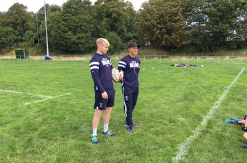 Matt and Callum passing on their rugby knowledge.