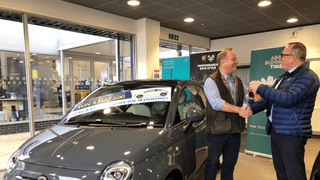 The Lucky Winner Collecting his New Car