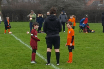 Captain Gibbons listens to the Ref ahead of kick off