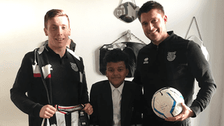 Grimsby Town midfielder Harry Clifton visits injured youth academy player Ruben Hilldrith