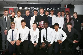 Grimsby Town U18 squad - EFL North East Youth Alliance champions 2018-19 - with Player of the Year Mattie Pollock in the centre