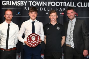 Grimsby Town U16 Player of the Year Luis Adlard with Craig Disley, Harry Clifton, and Michal Pujdak