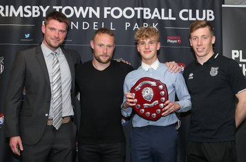 Grimsby Town U14 Player of the Year Louis Boyd with Michal Pujdak, Ben Davies, and Harry Clifton