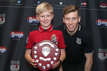 Grimsby Town U12 Player of the Year Callum Storr with Harry Clifton