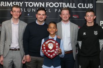 Grimsby Town U11 Player of the Year Harry Olufowobi with James Coulbeck, Sam Vincent, Lawrence Heward, and Max Wright